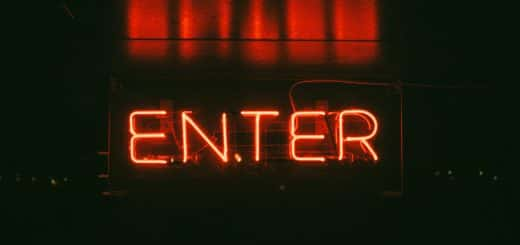 come in enter neon sign