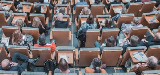 Adults sitting in a lecture theatre