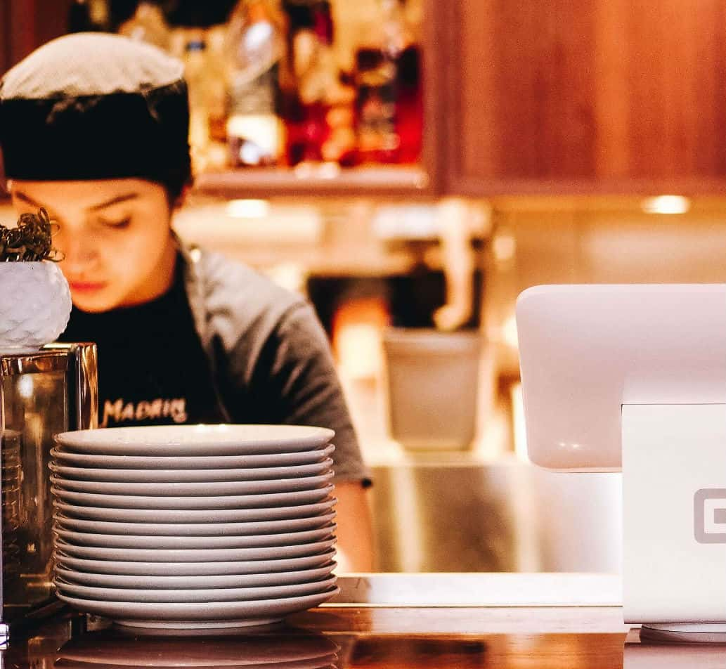 Photograph of woman at a restaurant counter