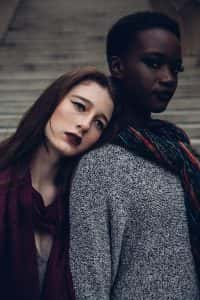 Two women leaning on each other