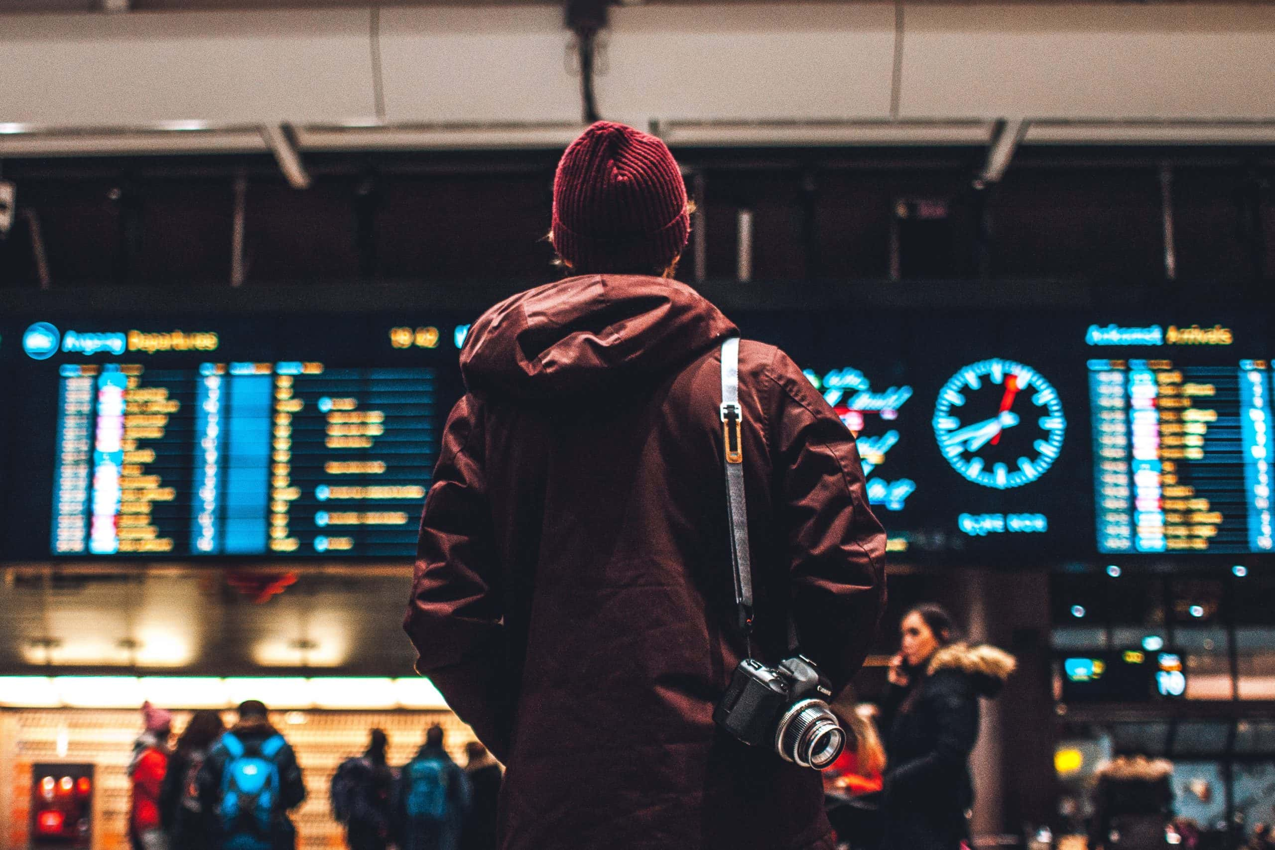 Person looking at airport departure board