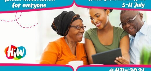 Banner for Health Information Week 2021 with a young woman holding a tablet device smiling at an older woman to her right with a man on the left looking on