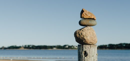 view of stones on a pole on a beach