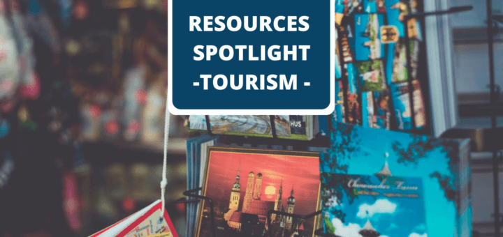 Postcards on a stand with text ' Resources Spotlight Tourism'